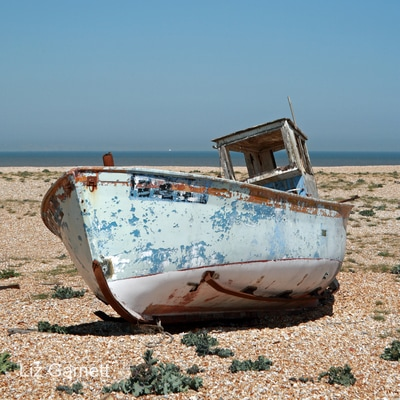 Old fishing boat on the shingle beach at Dungeness, Kent, by Liz Garnett