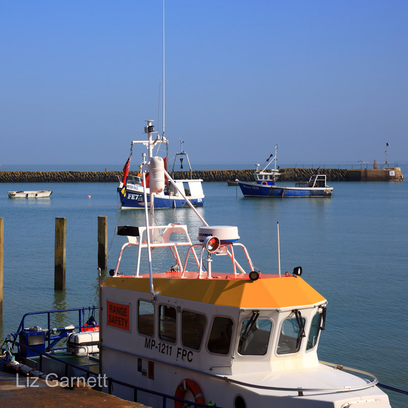 View of Fishing boats in Folkestone harbour, Kent, by Liz Garnett